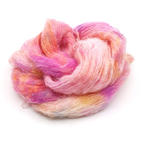 loose skein of brushed suri alpaca and silk in cream pinks and golden yellow