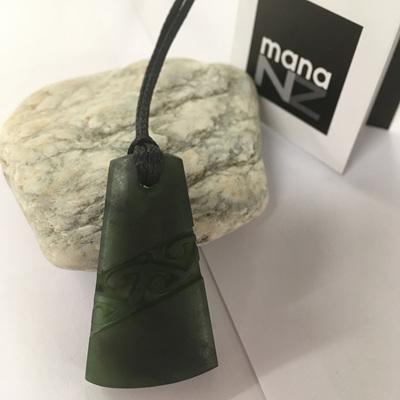 Mana NZ Greenstone Wedge Carved
