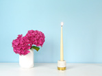 Marble and brass candle holder with white taper