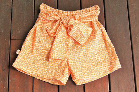 'Marlene' front-tie shorts, 'Scribble, Orange' 100% Cotton, 3 years