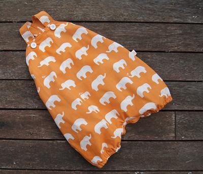 'Marlow' cross-back romper with crotch snaps, 'Ele Family, Orange' GOTS Organic Cotton, 6-12 mths