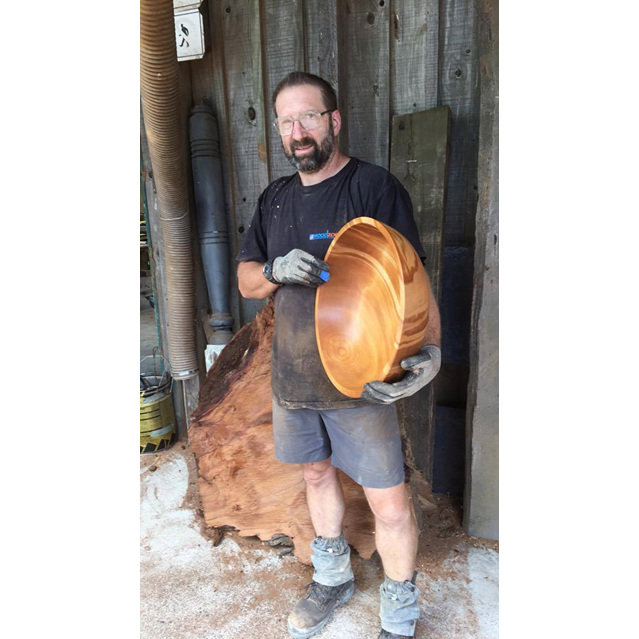 Matthew Vallings presenting the large kauri bowl he turned