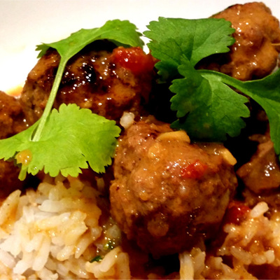 Meatballs in a coconut tomato sauce served with rice