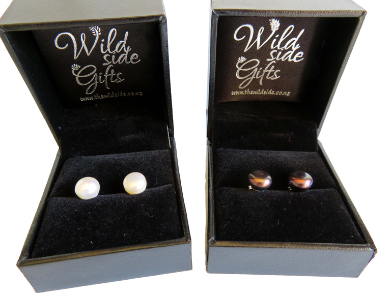 Medium sized freshwater pearl earrings in white and black.