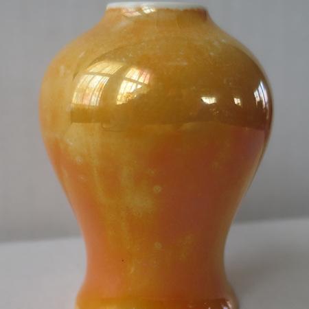 Miniature orange jugs and vases