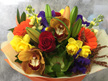 Mixed bouquet presentation in a water filled box Vox