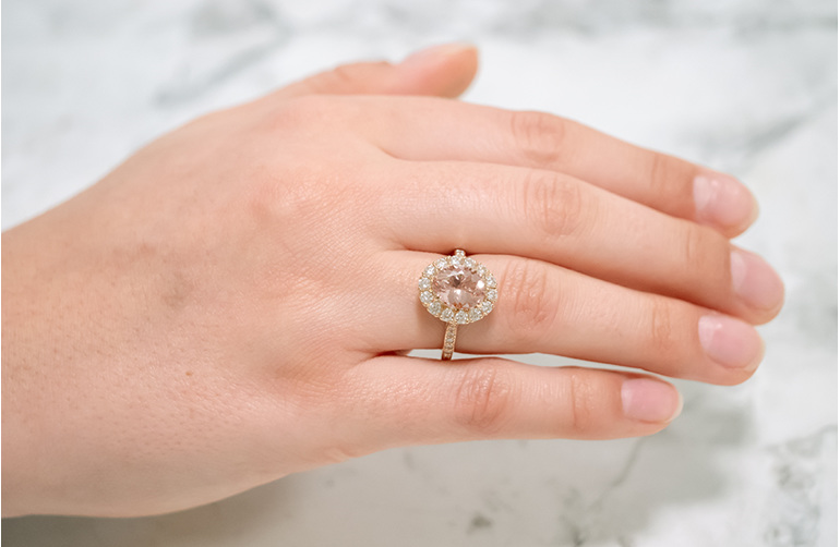Morganite and Diamond Halo Ring in 18ct Rose Gold showcased on hand