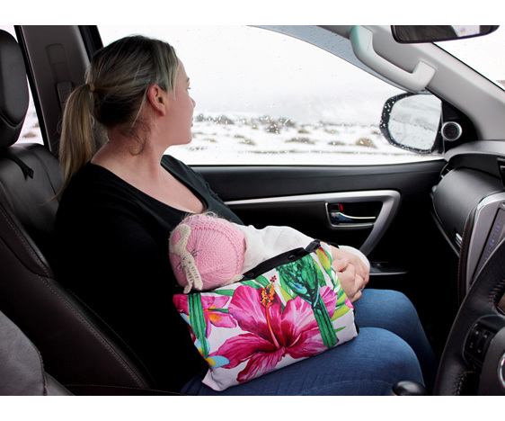 Mother breastfeedingher baby in a car using a babybaby nursing sleeve