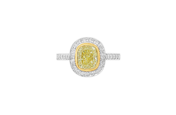 Natural Fancy Yellow diamond framed in yellow gold, surrounded by 44 diamonds