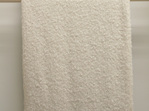 New Zealand Made Alpaca Throw Blanket Boucle Cream on Ladder