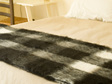 New Zealand Made Alpaca Throw Blanket on Bed