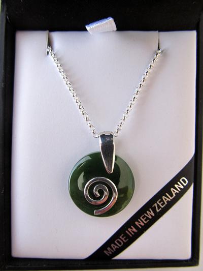 NN5023 Smooth round greenstone pendant with silver koru.