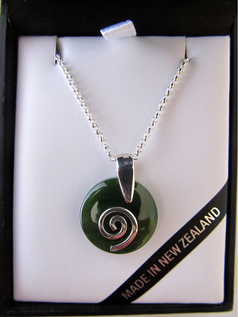 NN5023 Smooth round greenstone pendant with silver koru.