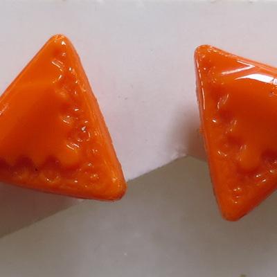 Bright orange triangular buttons