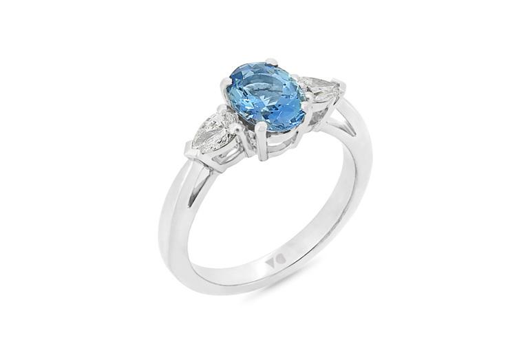oval blue aquamarine and pear diamond three stone dress ring