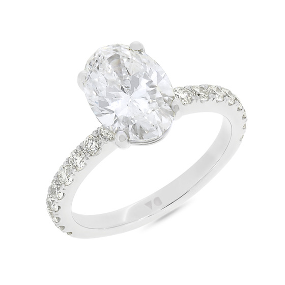 Oval Cut Claw Set Diamond Shoulder Ring