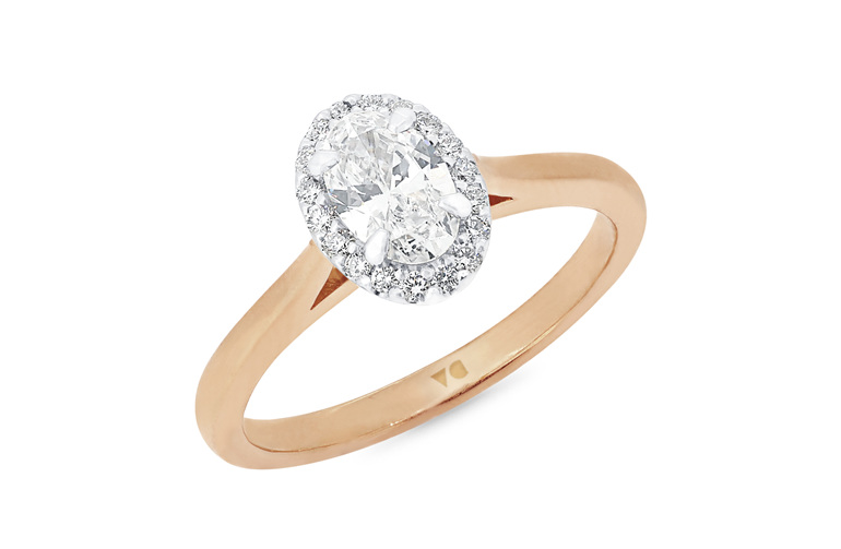 Oval diamond halo engagement ring in 18ct rose gold