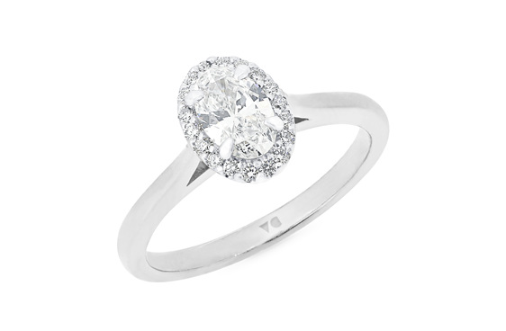 Oval diamond halo engagement ring in 18ct white gold platinum