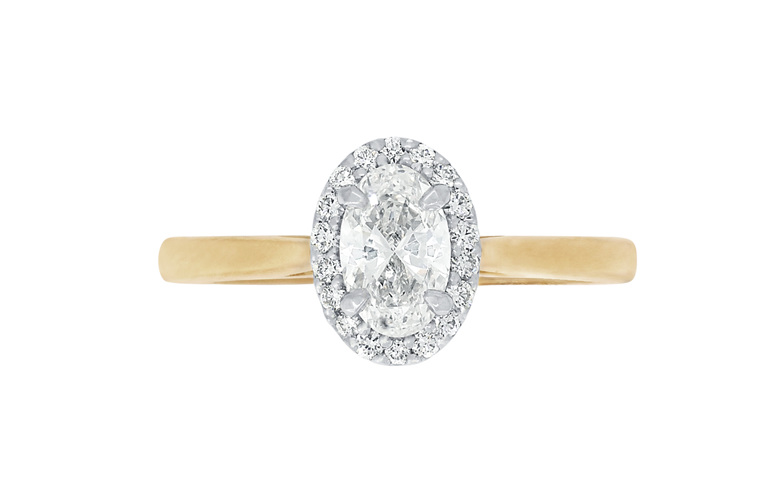 Oval diamond halo engagement ring in 18ct yellow gold