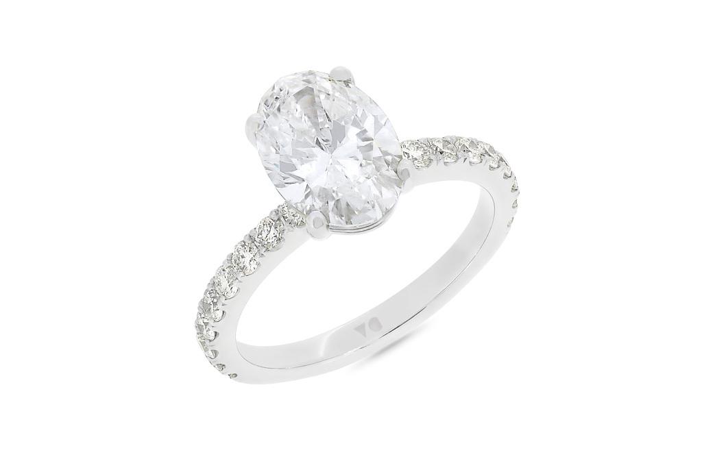 e1cb5c860ad82 Oval Cut Claw Set Diamond Shoulder Ring