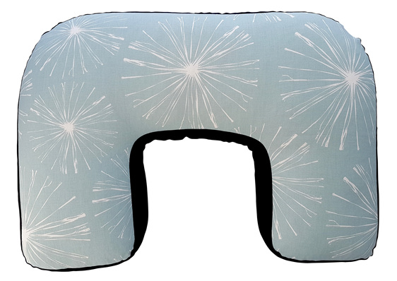 Pale blue U shaped nursing pillow with white bursting stars printed on it