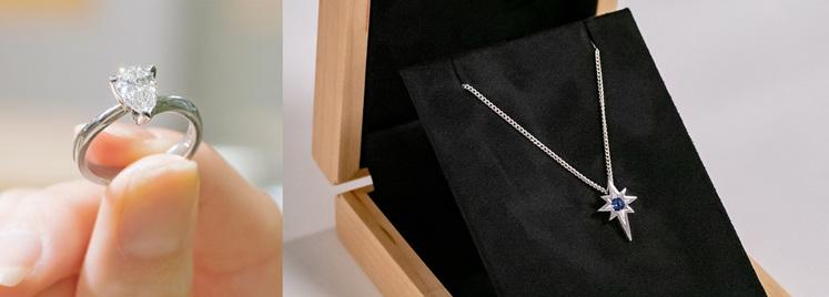 Pear cut diamond ring, blue sapphire starburst pendant in wooden jewellery box