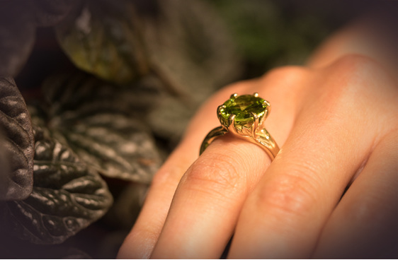 Peridot dress ring - yellow gold leaf detail