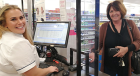 Pharmacist Jess dispenses electronic prescription in Amcal Coffs Harbour