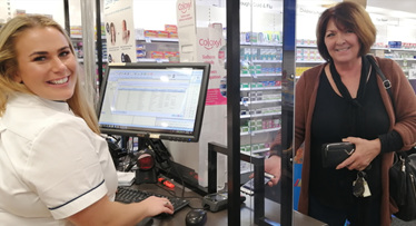 Pharmacist Jess dispenses electronic prescription in Amcal Coffs Harbour