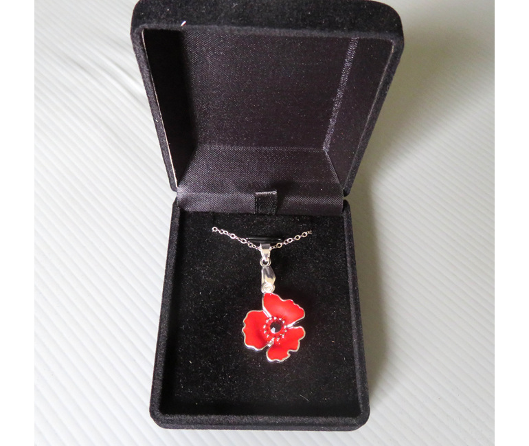 Poppy pendant in a jewellery box