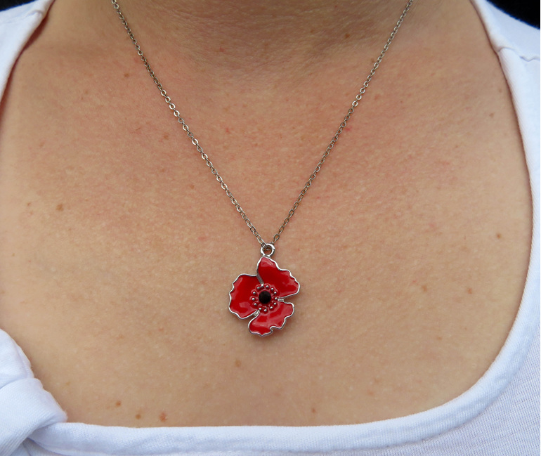 Poppy pendant on silver chain.
