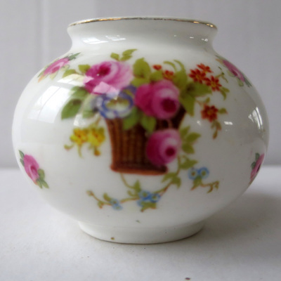 Pretty miniature vase with roses