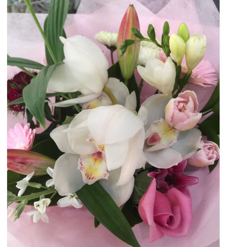 Pretty pink/pastel bouquet with Orchids deliveries Auckland wide