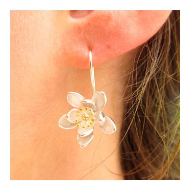 Pretty traveller's joy flower sterling silver drop earrings.