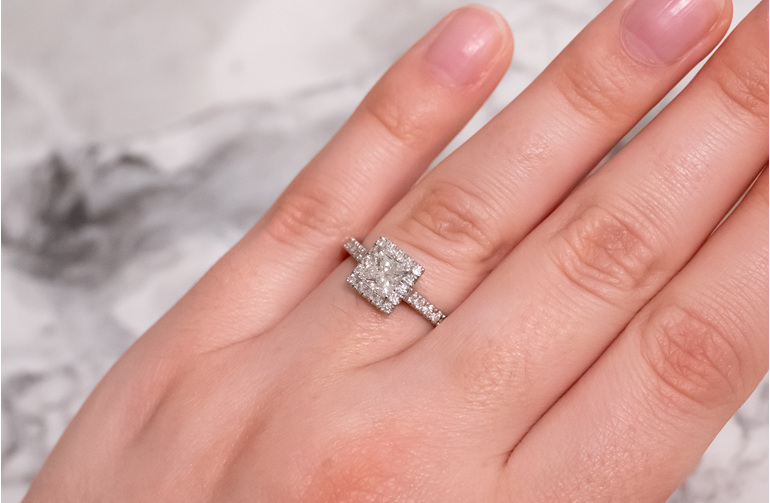 Princess cut diamond halo engagement ring with diamond set band, platinum