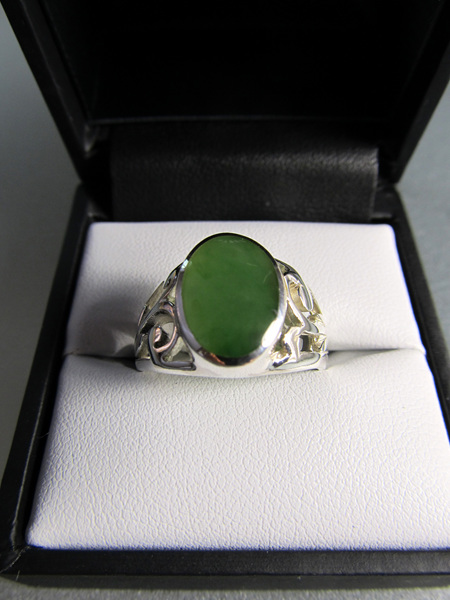 R200 Men's oval greenstone ring with koru detail in sterling silver.