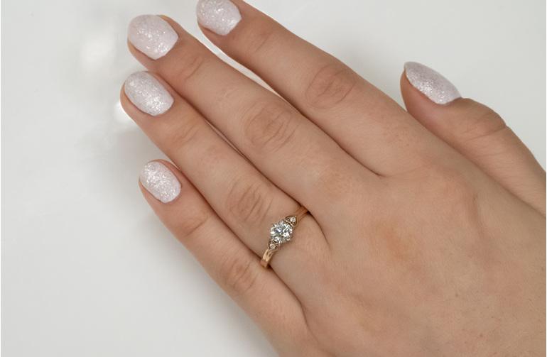 Raumati koru heart rose gold diamond solitaire engagement ring on hand