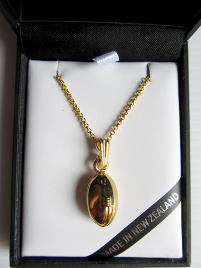 RB5050G Mana NZ Rugby Ball pendant on gold chain.