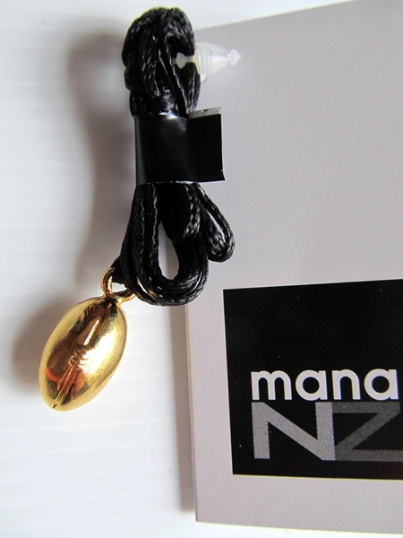 RB5060G Mana NZ Rugby Ball pendant, gold, on cord.