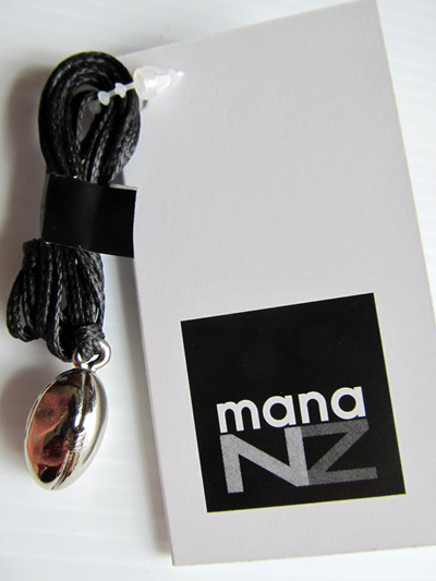 RB5060S Mana NZ Rugby Ball pendant, silver, on cord.