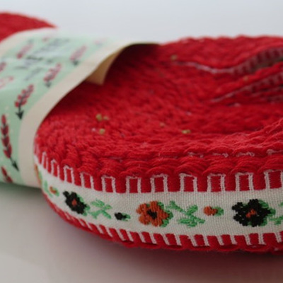 Red and white embroidered ribbon