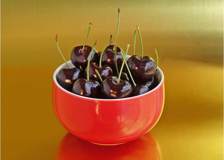 Red bowl of cherries