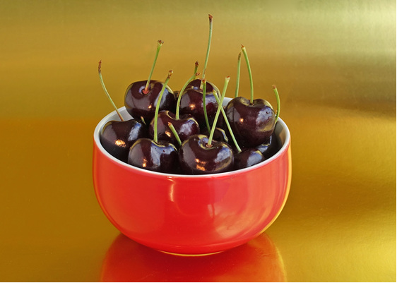 Red bowl of cherries