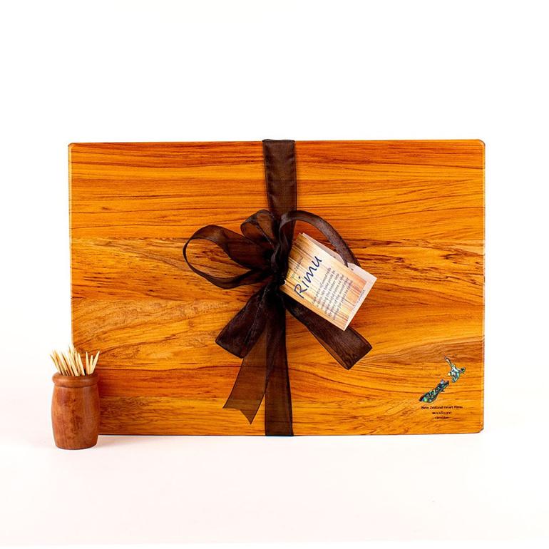 rimu board with paua kiwi