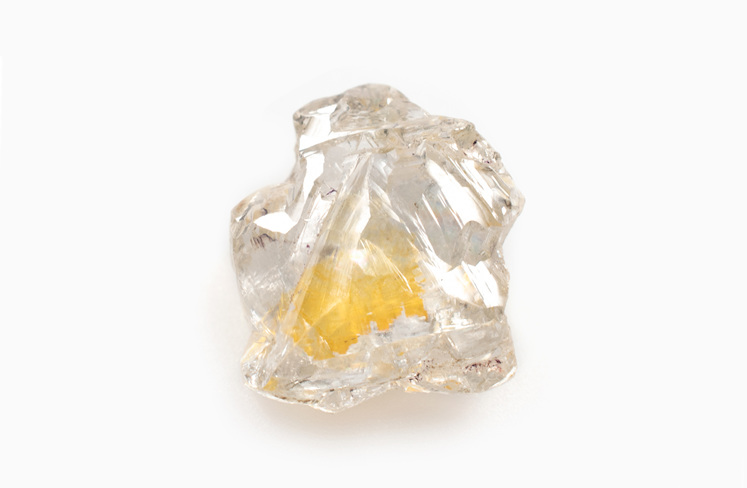 rough diamond with trapped nitrogen causing a yellow inclusion in the centre