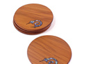 round ancient kauri coasters with paua kiwi