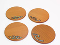 round ancient kauri coasters with paua korus