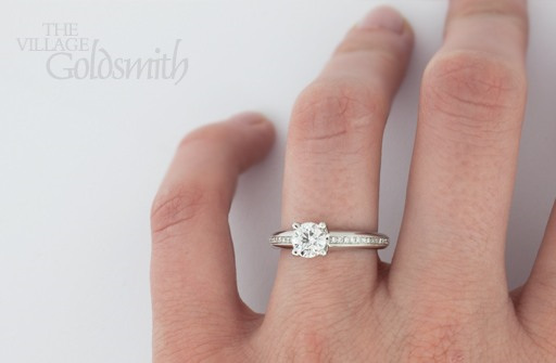 Round Brilliant Cut Diamond Ring with Shoulders on hand