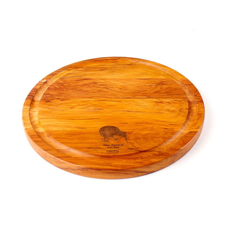 round cheese board with juice groove - kiwi - heart rimu