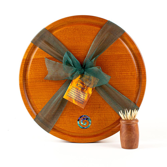 round cheese board with juice groove - paua koru - ancient kauri
